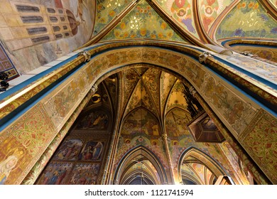 PRAGUE, CZECH REPUBLIC - MARCH 25, 2018: Neo-gothic interior of Basilica of St. Peter and St. Paul. Vysehrad castle complex. Drawings on walls and ceiling