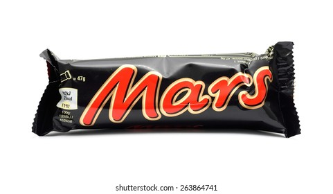 PRAGUE, CZECH REPUBLIC - MARCH 25, 2015: Wrapped MARS candy bar on a white background. It contains caramel, nougat and chocolate glaze. It is produced by Mars, incorporated.
