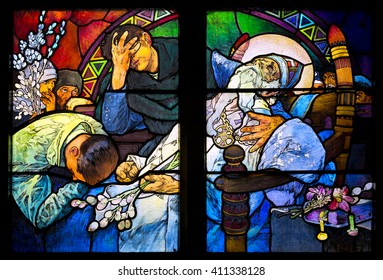 PRAGUE, CZECH REPUBLIC - MARCH 25 Close-up of the Art Nouveau stained glass window by Alfons Mucha, St. Vitus Cathedral, Prague on March 25, 2016