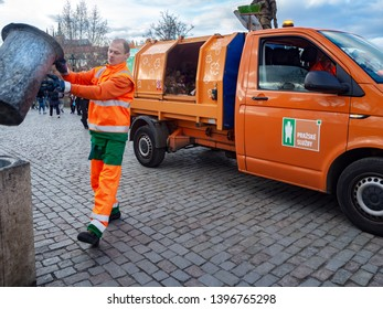 Prague, Czech Republic - March 26, 2019: The garbage collector is pouring garbage into the garbage truck.