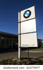 PRAGUE, CZECH REPUBLIC - MARCH 31: BMW car company logo in front of dealership building on March 31, 2017 in Prague, Czech republic. UK BMW workers back strike over pensions.