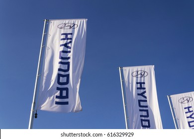 PRAGUE, CZECH REPUBLIC - MARCH 31: Hyundai company logo in front of dealership building on November 7, 2016 in Prague, Czech republic. Hyundai plans new platform for long range EVs and Genesis.