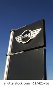 PRAGUE, CZECH REPUBLIC - MARCH 31: Mini automotive marque logo in front of dealership building on March 31, 2017 in Prague, Czech republic. BMW strikes set to disrupt Mini and Rolls-Royce production.
