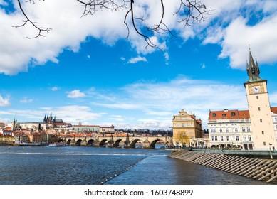 PRAGUE, CZECH REPUBLIC - MARCH 8, 2019: The Prague castle with historic Charles Bridge and Vltava river under blue sky. Prague is a popular travel destination. Prague, Czech Republic