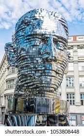 PRAGUE, CZECH REPUBLIC - MARCH 9, 2018: Moving statue of Franz Kafka in Prague, Czech republic. Artistic symbolic object. Architectural theme. Illustrative editorial.