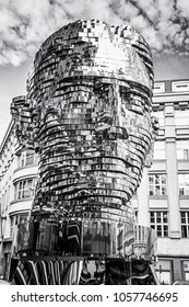 PRAGUE, CZECH REPUBLIC - MARCH 9, 2018: Moving statue of Franz Kafka in Prague, Czech republic. Artistic symbolic object. Architectural theme. Illustrative editorial. Black and white photo.