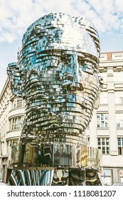PRAGUE, CZECH REPUBLIC – MARCH 9, 2018: Moving statue of Franz Kafka in Prague, Czech republic. Artistic symbolic object. Architectural theme. Illustrative editorial. Yellow photo filter.