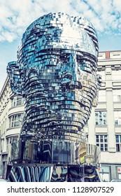 PRAGUE, CZECH REPUBLIC – MARCH 9, 2018: Moving statue of Franz Kafka in Prague, Czech republic. Artistic symbolic object. Architectural theme. Blue photo filter.