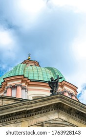 Prague / Czech Republic - May 03 2019: Architecture of the old Klementinum district, majestic dome of the Catholic Church in the Old Town, the isthmic quarter of Prague, Czech Republic