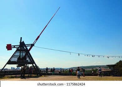 Prague, Czech Republic- MAY 08, 2018: People near Modern Prague Metronome monument and a scenic view point tourist attraction at spring sunny day.