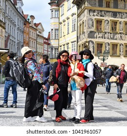 PRAGUE, CZECH REPUBLIC – May 1, 2017: Tourists make a photo against the background of old architecture.
