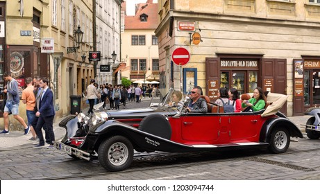 PRAGUE, CZECH REPUBLIC - May 1, 2018: A vintage car for tourist trips on the city street.