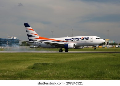 PRAGUE, CZECH REPUBLIC - MAY 13: Smart Wings Boeing 737-7Q8 lands at PRG Airport on May 13, 2015.Smart Wings is a brand of the Czech Travel Service Airlines.