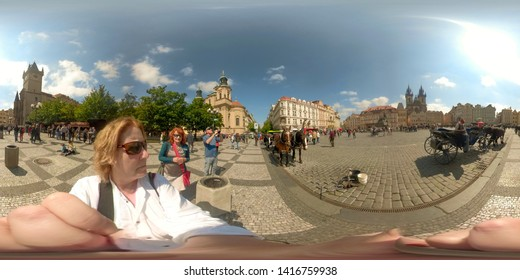 Prague, Czech Republic - May 14, 2019 :  360VR of tourists in Old Town Square of Prague, Czech Republic.