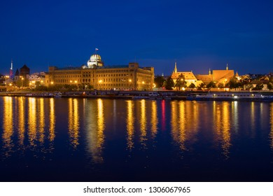 Prague, Czech republic - May 15 2015: Vltava riverside with buildings of the Czech Ministry of Industry and Trade (left) and medieval convent of St. Agnes of Bohemia. Night scene with lights on water.