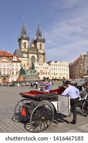 Prague, Czech Republic - May 16, 2013: Coachman with carriage and the Church Of Our Lady Before Tyn at Old Town Square in Prague Czech Republic Europe.