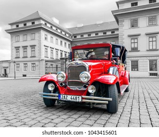 PRAGUE, CZECH REPUBLIC - MAY 17, 2016: A red retro car on the street in Prague. Machines are used for tourist excursions in Prague