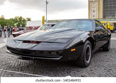"""Prague / Czech Republic - May 18th 2019: Front view of a black Pontiac Firebird Trans Am """"KITT"""" at car show Legendy 2019."""