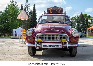 Prague / Czech Republic - May 18th 2019: Wine red Skoda Octavia Combi (1964) with vintage parasol and chairs in background at car show Legendy 2019.