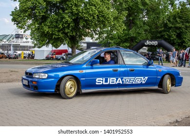 Prague / Czech Republic - May 18th 2019: Riddiculous blue Subaru Impreza made of two front parts and fully operating on the road at car show Legendy 2019.