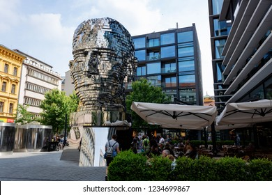 Prague, CZECH REPUBLIC - MAY 19, 2018: Moving sculpture head of Franz Kafka, Metalmorphosis by Czech artist David Cerny, is 11 metres tall w 42 rotating panels near of Quadrio shopping centre.