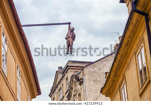 PRAGUE, CZECH REPUBLIC - MAY 19: a unique sculpture of Sigmund Freud, grabbed one hand for the roof in Prague on Husova Street May 19, 2016
