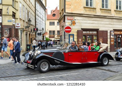 PRAGUE, CZECH REPUBLIC - May 2, 2018: A vintage car for tourist trips on the city street.