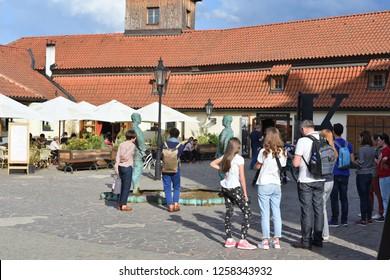 PRAGUE, CZECH REPUBLIC - May 2, 2018: Piss - sculpture and fountain by David Černý, installed outside the Franz Kafka Museum in Malá Strana.