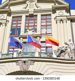 PRAGUE, CZECH REPUBLIC - May 2, 2018: Flags of the European Union, CZECH REPUBLIC and the city of Prague on the facade of the modern building of the PRAGUE CITY Hall.