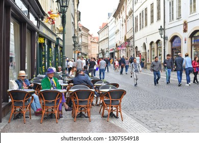 PRAGUE, CZECH REPUBLIC - May 2, 2018: Tables restaurant in the old streets of the city.