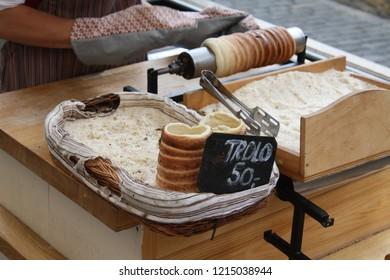 Prague, Czech Republic - May, 2014: Trdelnik, a traditional bread-like cylinder roll sold by street baker.