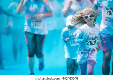 Prague, Czech Republic - May 21 2016: People participating in the Color Run. The Color Run is a worldwide hosted 5K fun race.