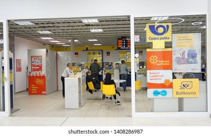 Prague / Czech Republic - May 23 2019:  Modern Czech Post (Ceska Posta) office in Fenix shopping Mall, showing people waiting for their turn, logos and poster displayed on the glass wall