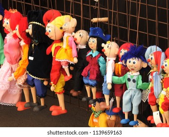 Prague, Czech Republic, May 24, 2018. Bright and Cheerful Marionettes for Sale on the Streets of Prague