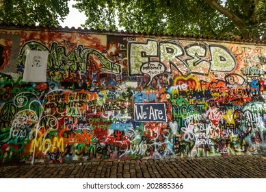 PRAGUE, CZECH REPUBLIC - May 24:The Lennon Wall since the 1980s filled with John Lennon-inspired graffiti and pieces of lyrics from Beatles songs on May 24, 2014 in Prague, Czech Republic
