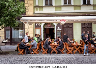 PRAGUE, CZECH REPUBLIC - MAY 25, 2017: People have a lunch on Ovocny square in the Old Town of Prague.