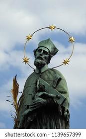 Prague, Czech Republic, May 25, 2018. St. John of Nepomuk Statue with Golden Star Halo on Charles Bridge