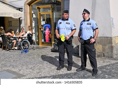 PRAGUE, CZECH REPUBLIC - May 25, 2019: Employees of patrol of the municipal police on the town square of Prague