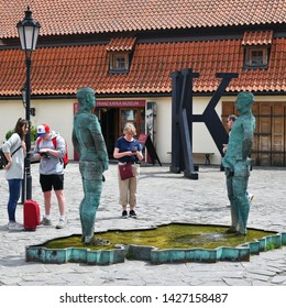 PRAGUE, CZECH REPUBLIC - May 25, 2019: Piss - sculpture and fountain by David Černý, installed outside the Franz Kafka Museum in Malá Strana.