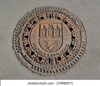 PRAGUE, CZECH REPUBLIC - MAY 25, 2014: - Hatch cover with the coat of arms of the Prague
