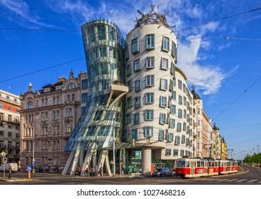 "PRAGUE, CZECH REPUBLIC - MAY 3 2017: Prague tram near Dancing modern house named ""Fred and Ginger"""