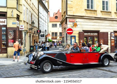 PRAGUE, CZECH REPUBLIC - May 4, 2018: A vintage car for tourist trips on the city street.