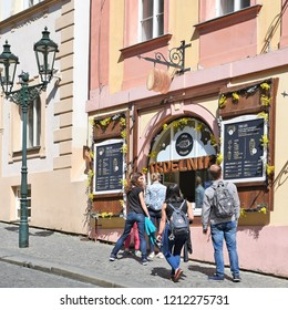 PRAGUE, CZECH REPUBLIC - May 4, 2018: Baking and sale of trdelnik on the old city street.