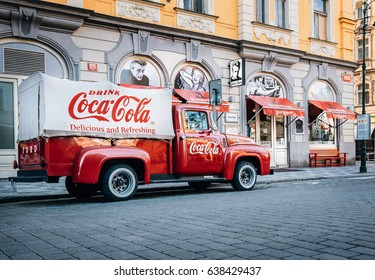 Prague, Czech Republic – May 7, 2017: An old renovated 1930 – 1940s  Coca-Cola red delivery pickup truck 1934 Ford parking on the Prague street  in Prague, Czech Republic