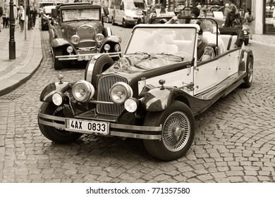 PRAGUE, CZECH REPUBLIC - May 7, 2017: A vintage car for tourist trips on the city street.