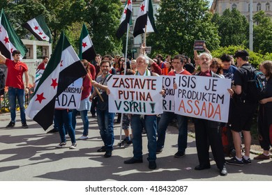 """PRAGUE, CZECH REPUBLIC - MAY 8, 2016: People demonstrate during liberation day against rising xenophobia under the motto """"We will not stay silent"""""""