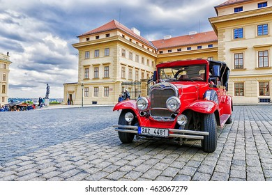 PRAGUE, CZECH REPUBLIC MAY-17 : Red old car waiting for tourists on the street in Prague on May 17, 2016. These cars are usually rented by tourists visiting Prague