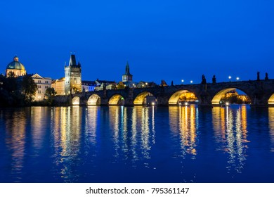 Prague, Czech Republic: Night landscape of Charles Bridge and its reflactions in the Vltava river.