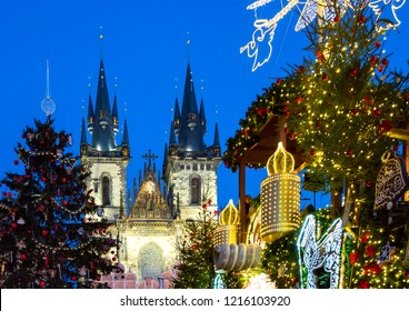Prague, Czech Republic,  night view of the Christmas market  in the Old City square, with the towers of Our Lady of Tyn church in the background