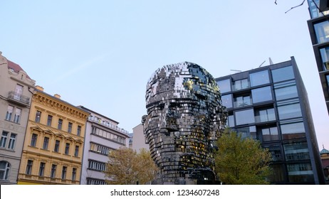 Prague, Czech Republic - Nov 5, 2018: the statue of Franz Kafka, eleven-metre-high statue is a 21st-century technical marvel of Prague. Forty-two moving panels form the face of the great Czech writer.